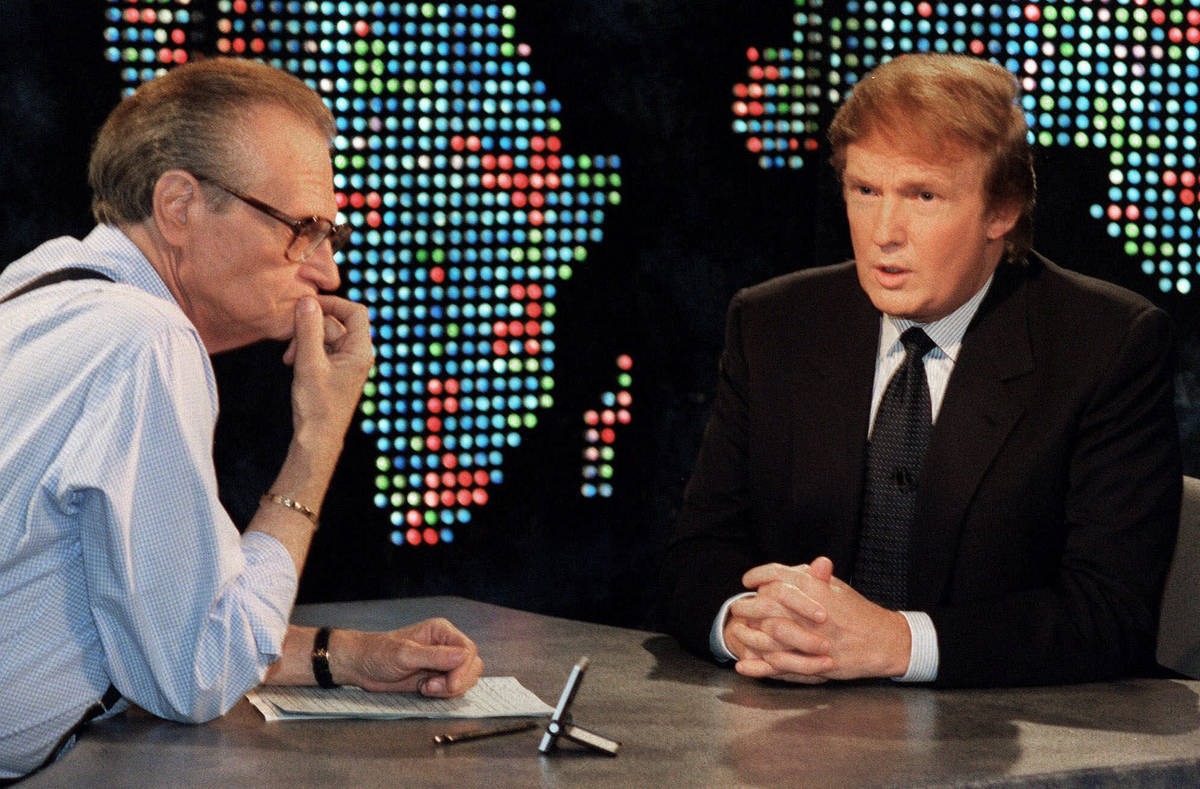 FILE - In this Oct. 7, 1999 file photo, Donald Trump, right, is interviewed by Larry King durin ...