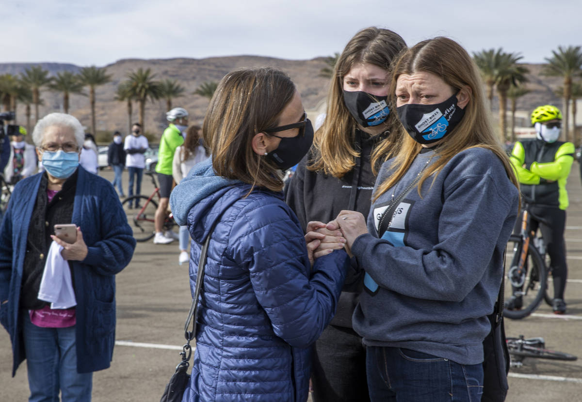 Donna Trauger, left, talks with Jasmine Ahmet, 17, center and her mother Angela Ahmet, right, d ...