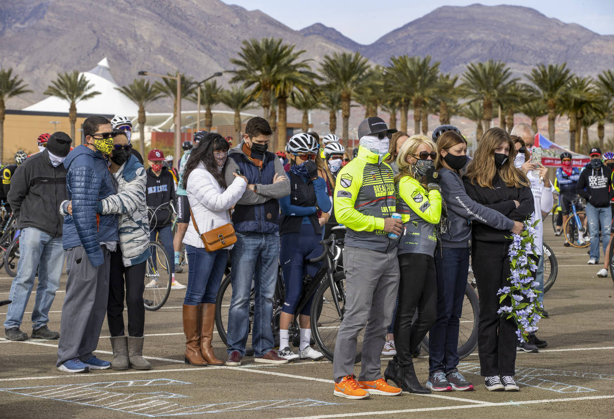 Friends and family gather to honor the five cyclists recently killed in Searchlight during the ...