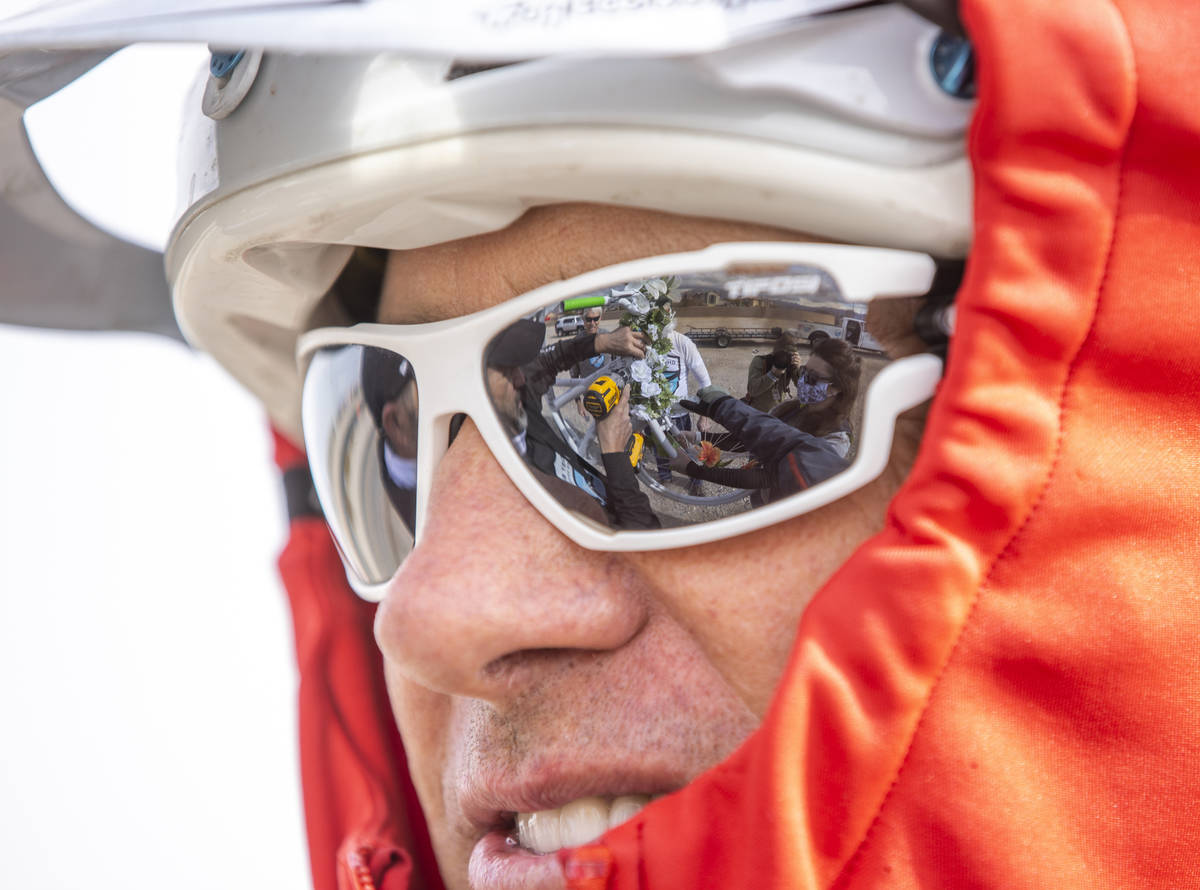 The crew are reflected in Jared Fischer's sunglasses as they mount the newest bike near the int ...