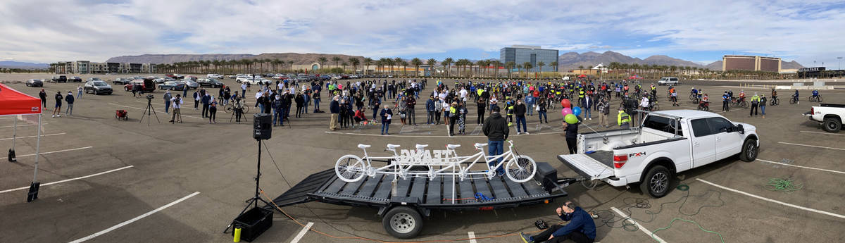 Panoramic as friends and family gather about the Ghost Bike to honor the five cyclists recently ...