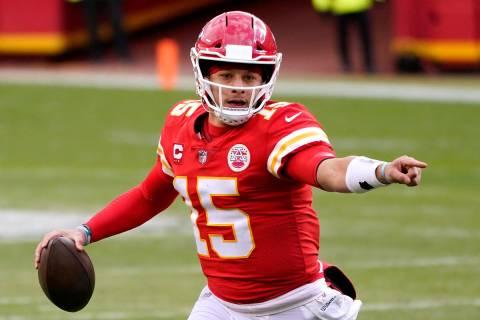 Kansas City Chiefs quarterback Patrick Mahomes looks for a receiver during the second half of a ...