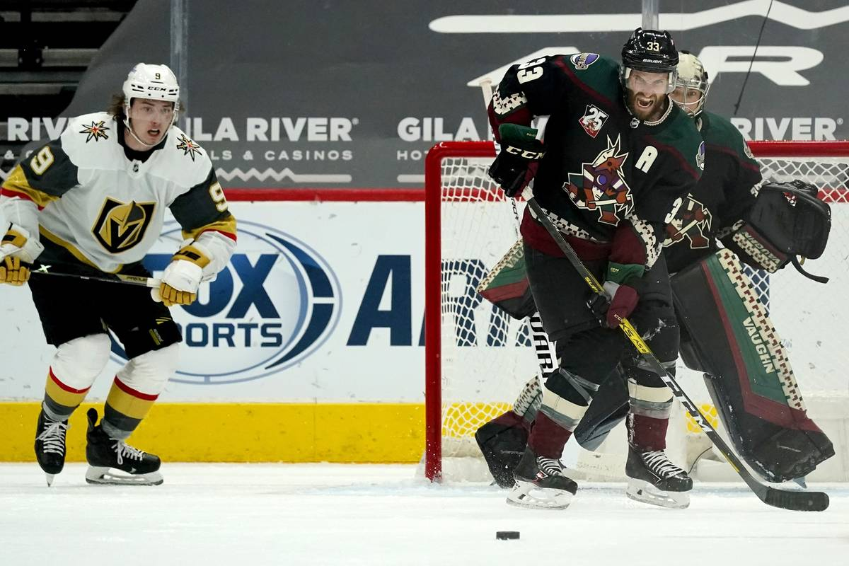 Arizona Coyotes defenseman Alex Goligoski (33) reacts as he watches the puck in front of Coyote ...