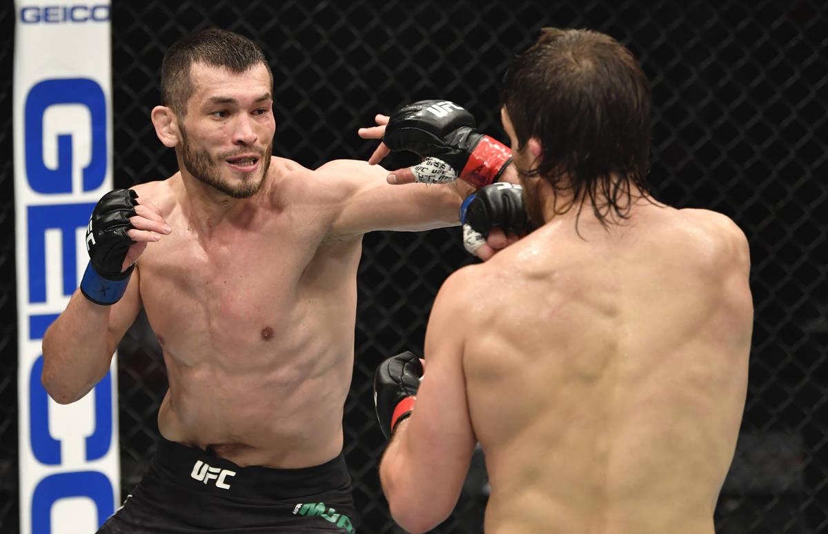 ABU DHABI, UNITED ARAB EMIRATES - JANUARY 23: (L-R) Makhmud Muradov of Uzbekistan punches Andre ...