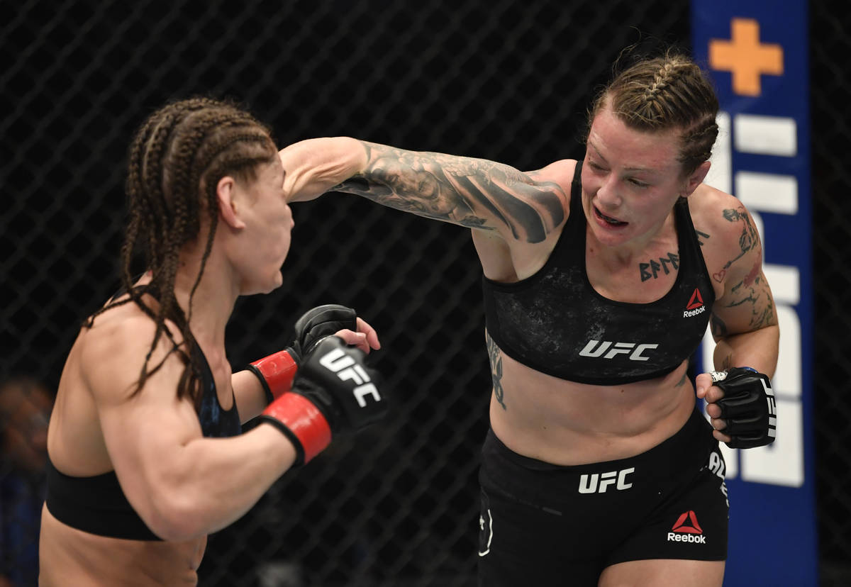 ABU DHABI, UNITED ARAB EMIRATES - JANUARY 23: (R-L) Joanne Calderwood of Scotland punches Jessi ...