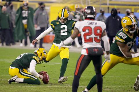 Green Bay Packers kicker Mason Crosby (2) kicks a 26-yard field goal against the Tampa Bay Bucc ...