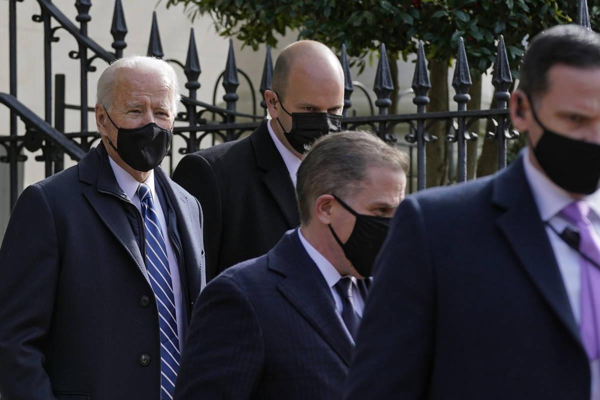 President Joe Biden departs after attending mass at Holy Trinity Catholic Church, Sunday, Jan. ...