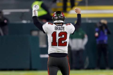 Tampa Bay Buccaneers quarterback Tom Brady reacts after winning the NFC championship NFL footba ...