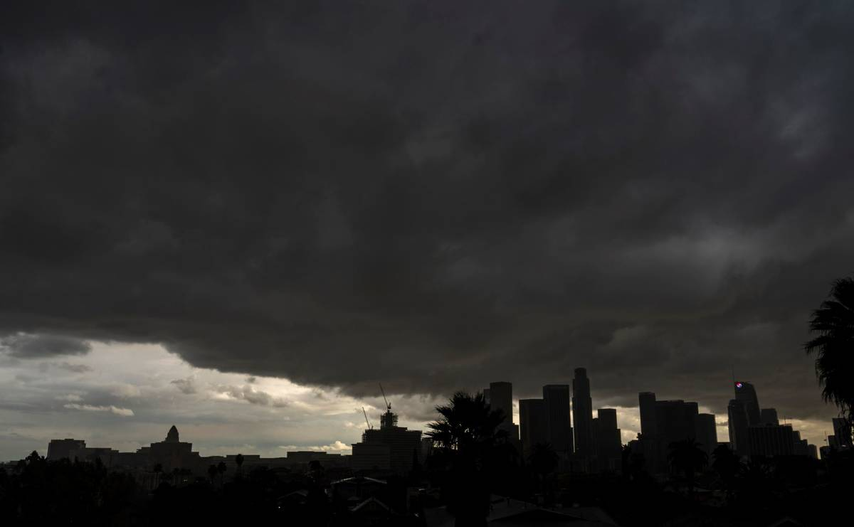 Heavy clouds move over Los Angeles city skyline Saturday, Jan. 23, 2021. (AP Photo/Damian Dovar ...