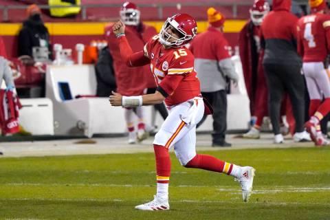 Kansas City Chiefs quarterback Patrick Mahomes celebrates after throwing a 5-yard touchdown pas ...