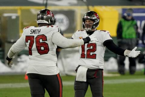 Tampa Bay Buccaneers quarterback Tom Brady celebrates with Donovan Smith after winning the NFC ...