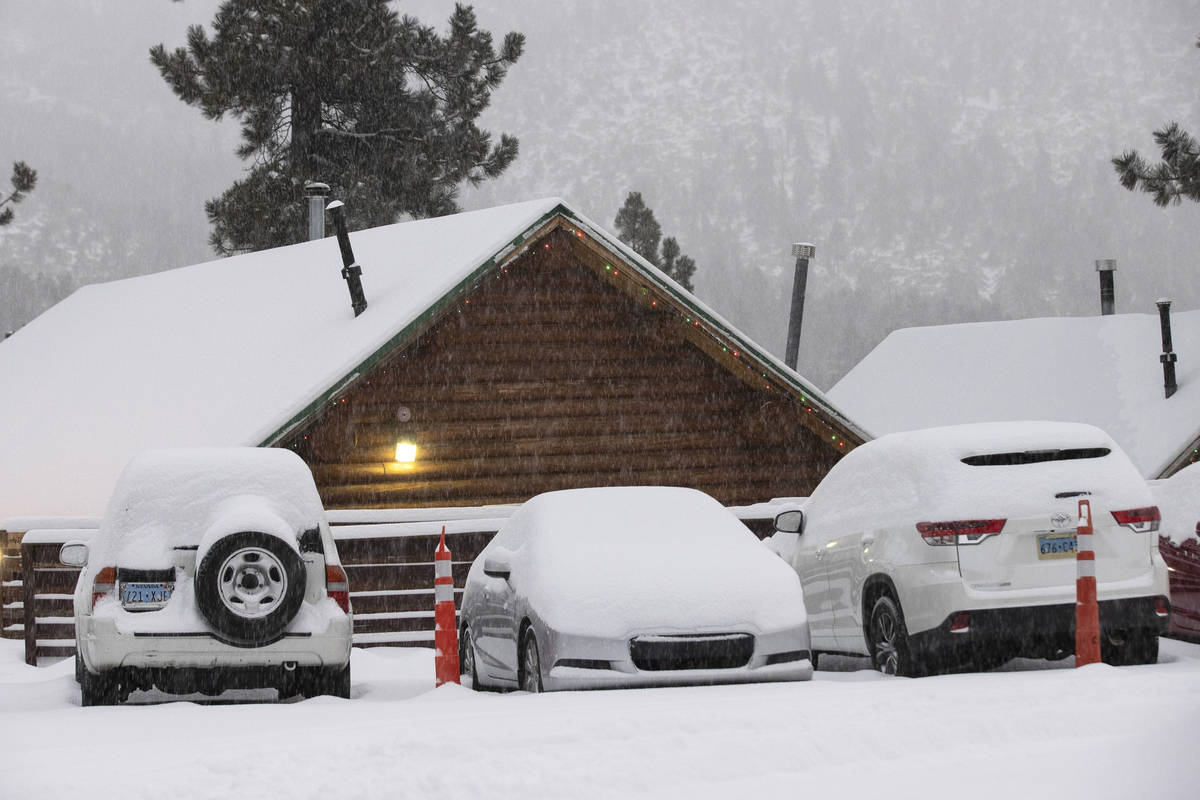 Snow covered cars are seen at The Charleston Lodge, on Monday, Jan. 25, 2021, in Mount Charlest ...