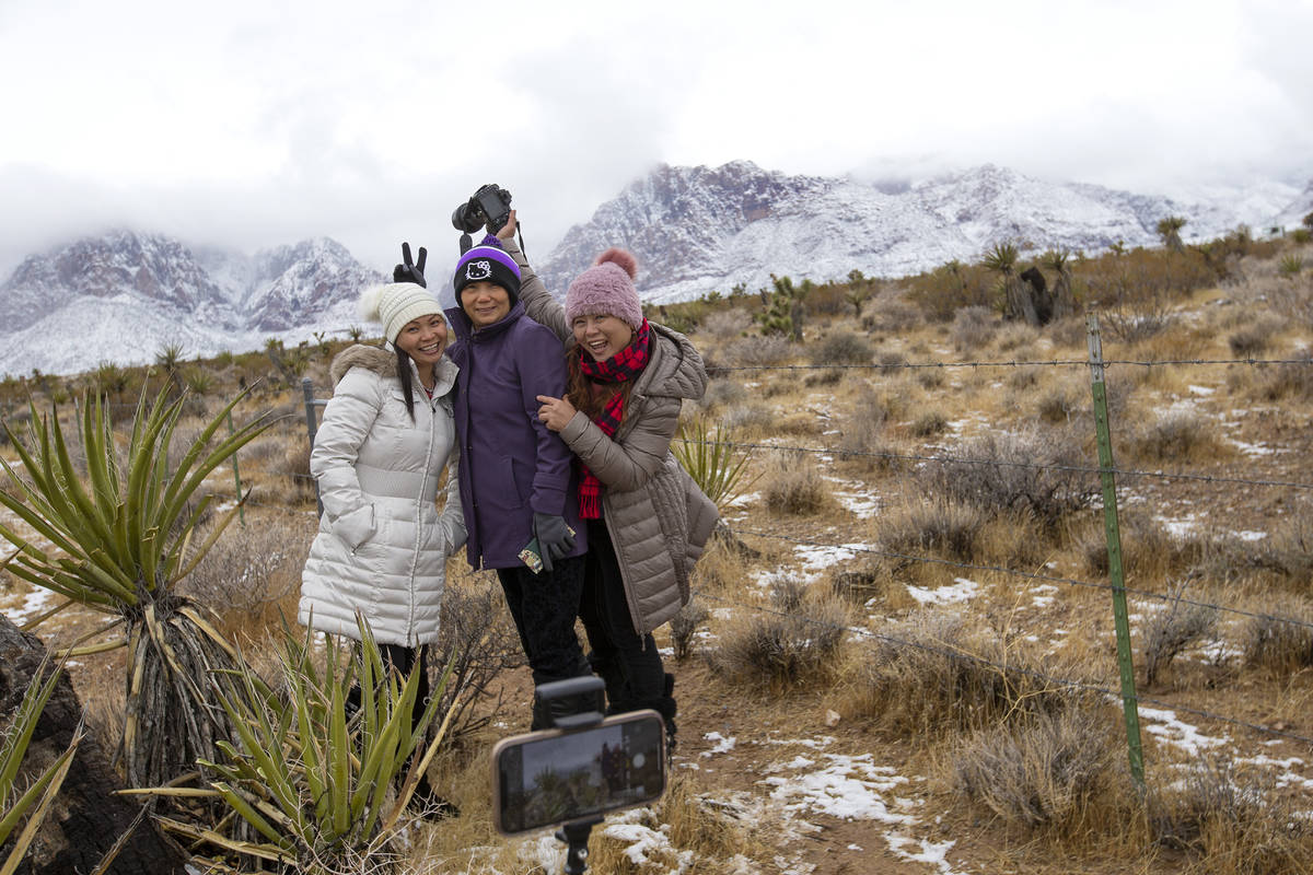 Tina Fang, left, Jenet Lu and Angel Fang pose for a photo while enjoying the snow at Red Rock N ...