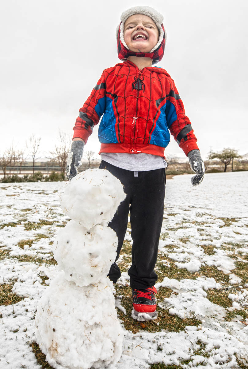 Rowan Whitehead, 3, smiles after making a snowman at Knickerbocker Park on Monday, Jan. 25, 202 ...