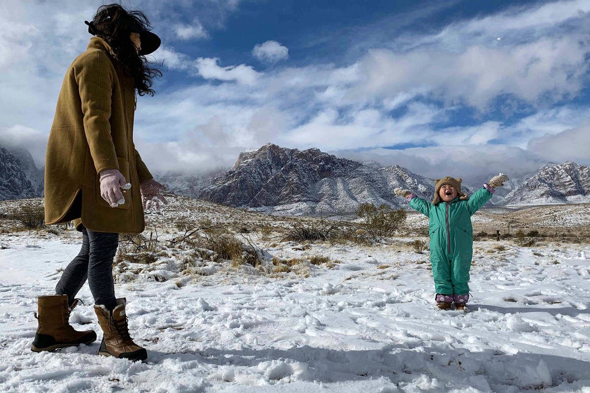 Ludia Kochan, of Las Vegas, plays in the snow with her son Jaxon Kochan (3) at Red Rock Canyon ...