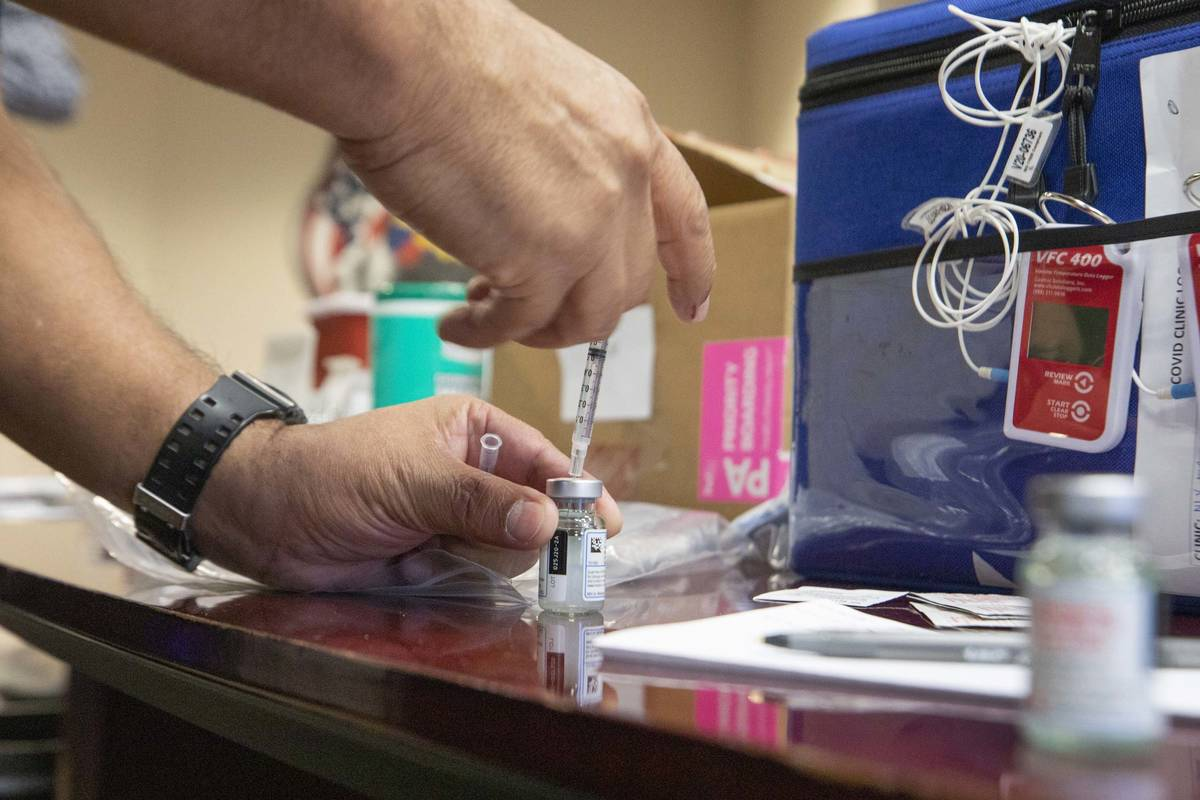 The North Las Vegas Fire Department administrates it's first batch of a COVID-19 vaccines to fi ...