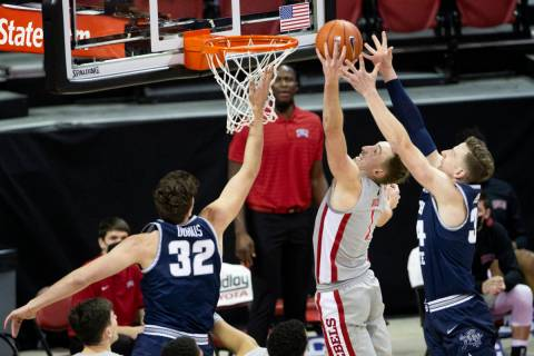UNLV's forward Moses Wood (1) blocks a shot from Utah State's forward Justin Bean (34) during t ...