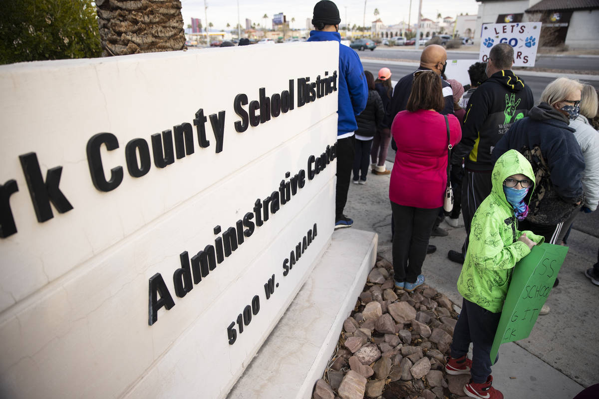 J. Adams, 8, protests Clark County School District's decision to cancel winter and fall sports ...