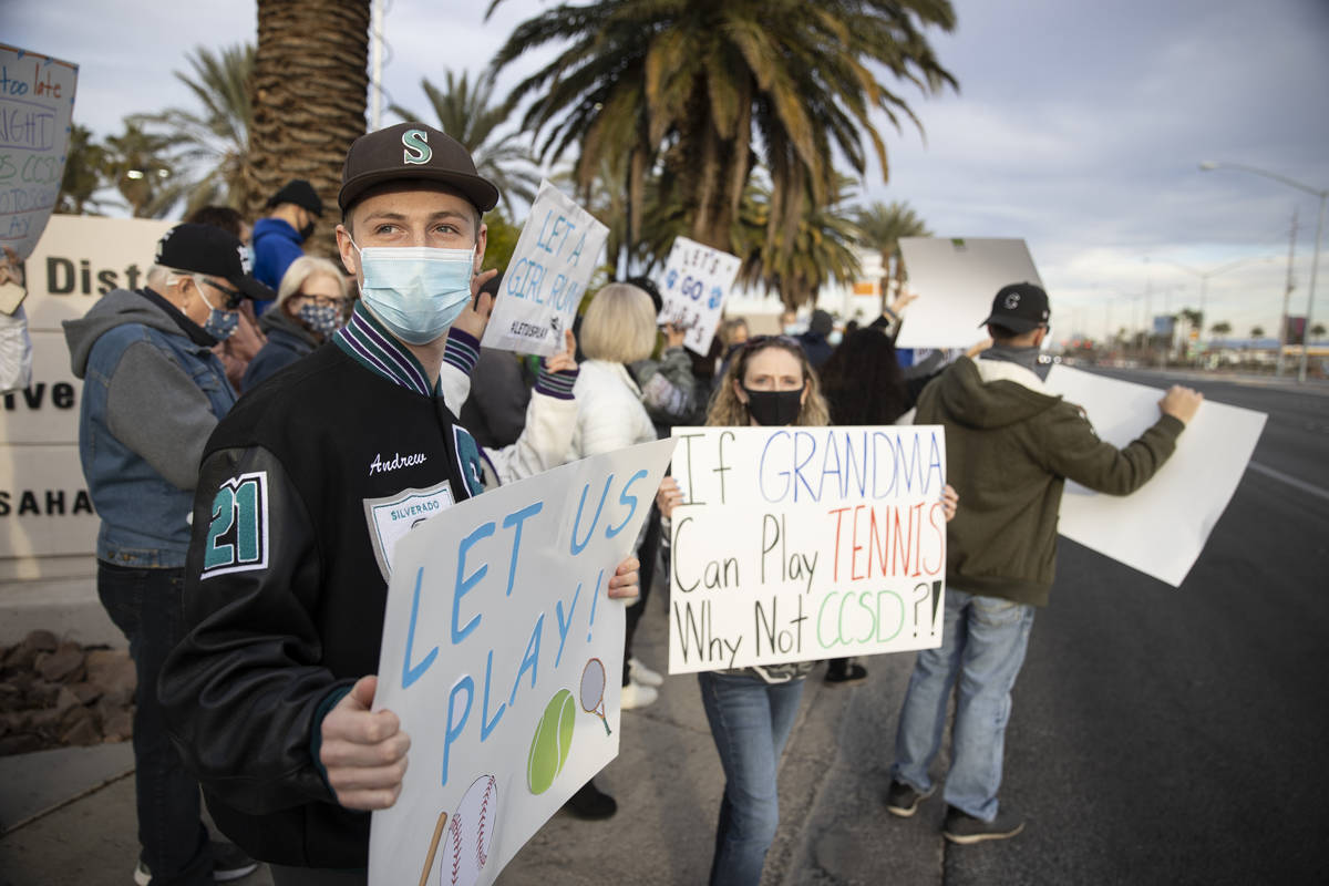 Andrew Maxwell, 18, a senior at Silverado High School, with his mother Staci, protest Clark Cou ...