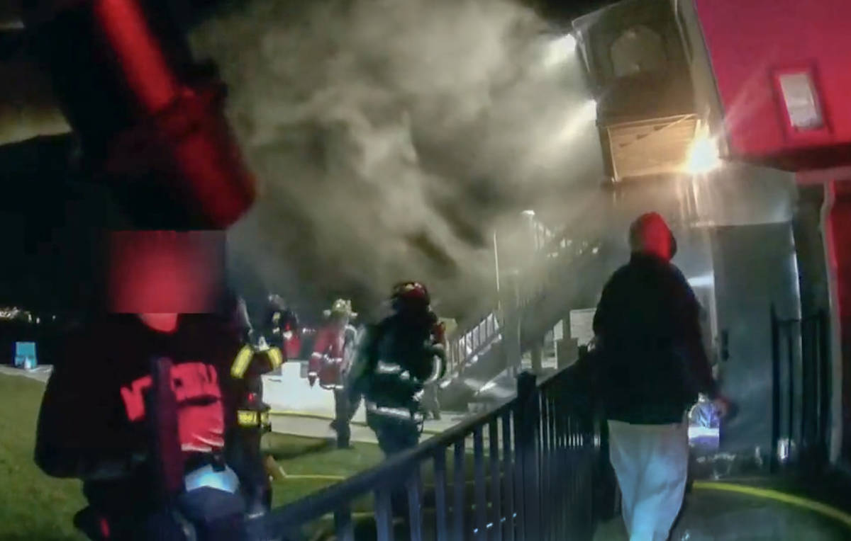 This frame grab from video provided by the New London Police Department shows firefighters res ...