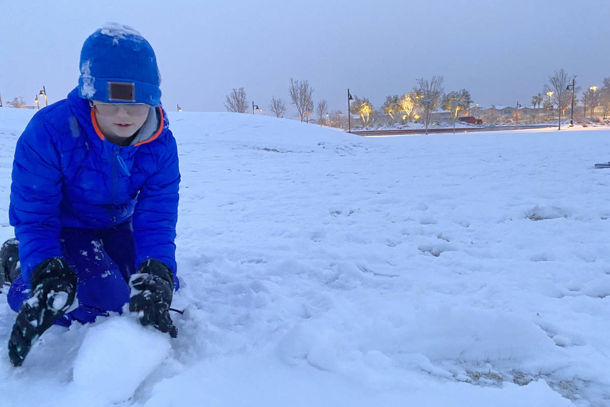 Justin Buzoff, 13, builds a snowman at Fox Hills Park on the far west side of the Las Vegas Val ...