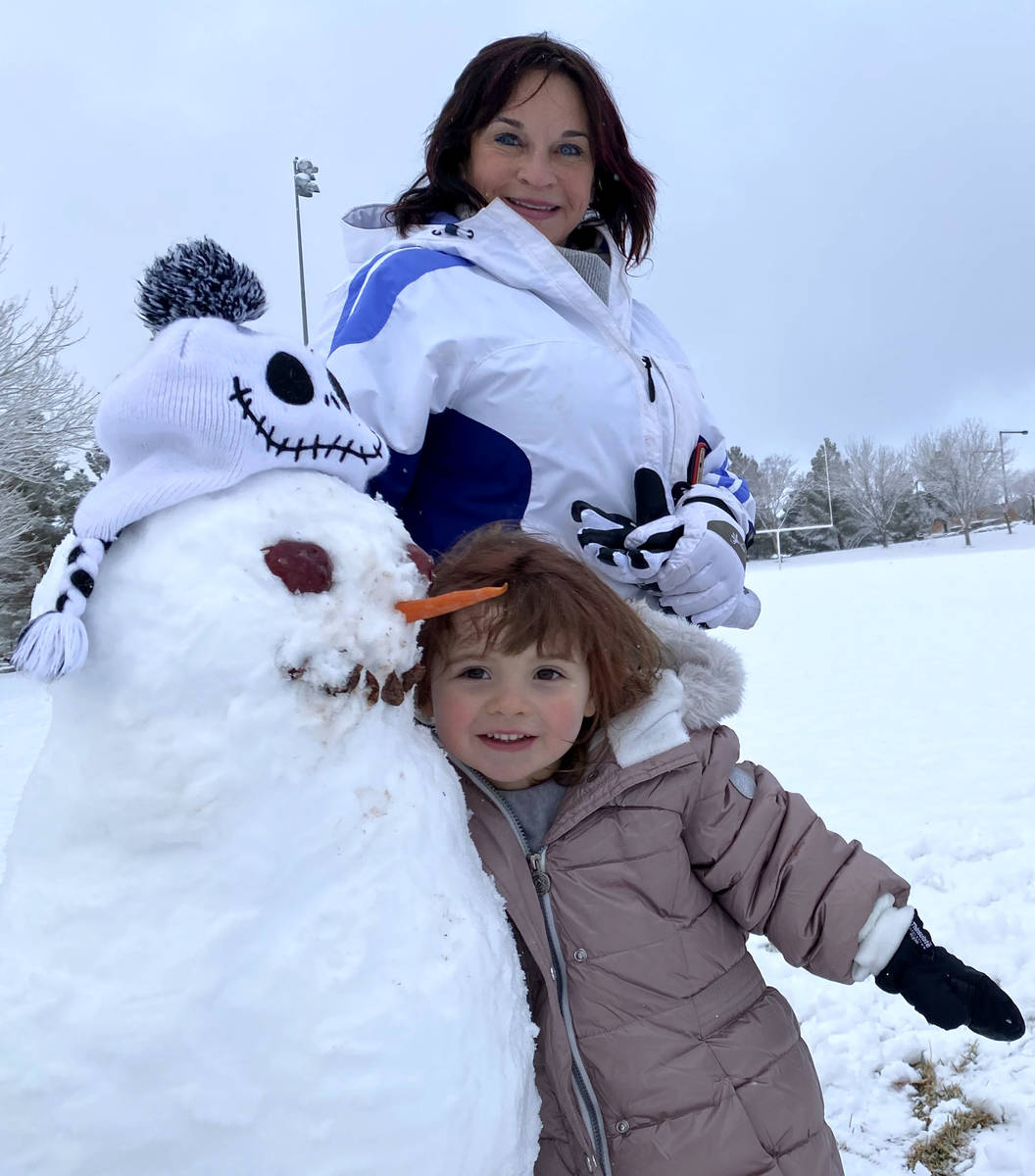 Rylie OՂrien, 3, and her grandmother Lisa Hauger pose for a photo with a snowman after ma ...