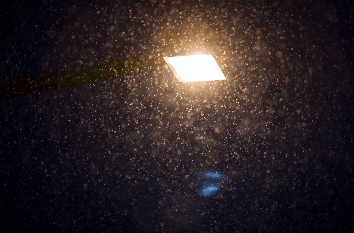 Snow flurries come down in Summerlin near Gardens Park on Tuesday, Jan. 26, 2021, in Las Vegas ...