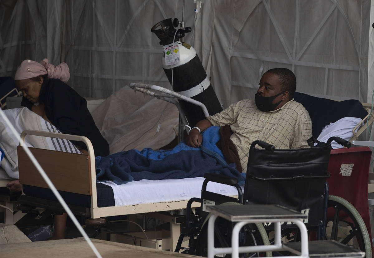A patient lays in his bed at the Steve Biko Academic Hospital's outside parking area in Pretori ...