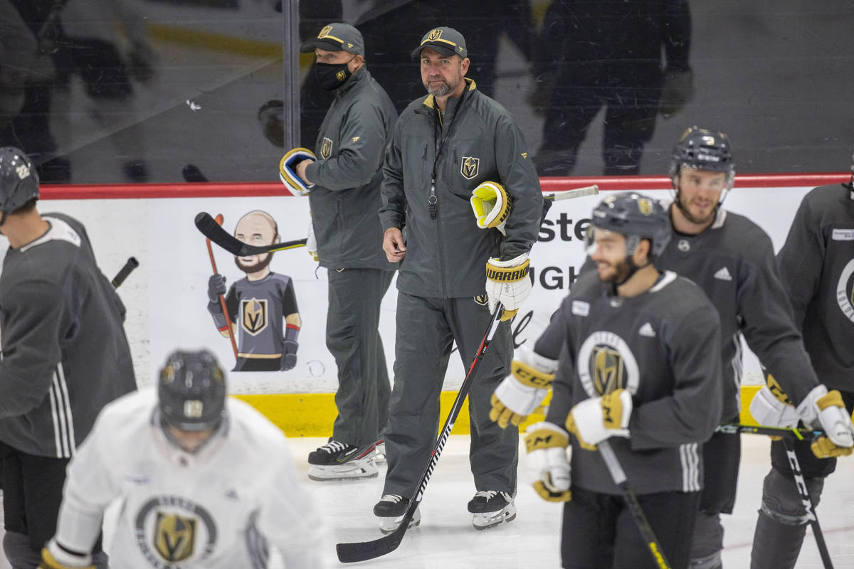 Vegas Golden Knights head coach Pete DeBoer looks on as the team disperses from a meeting on th ...