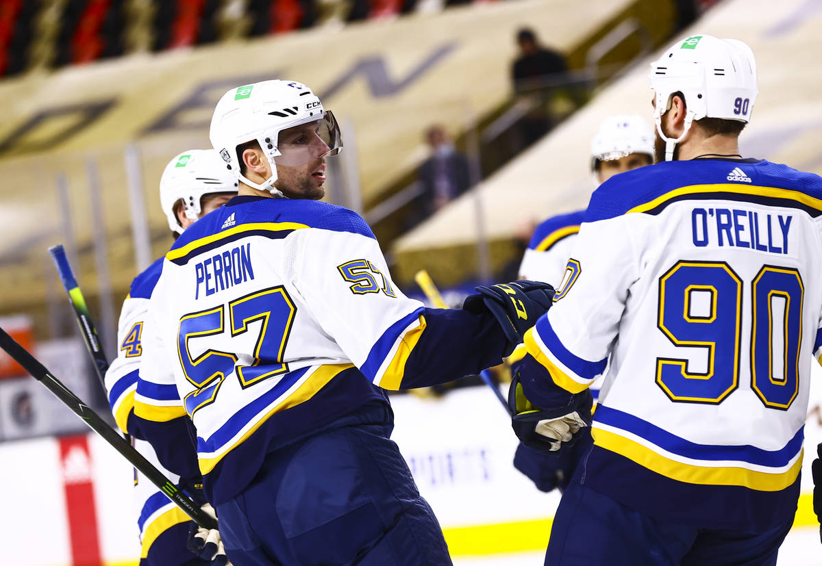 St. Louis Blues left wing David Perron (57) celebrates with his team after scoring against the ...