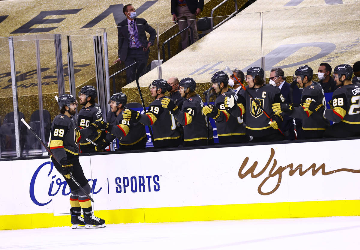 Golden Knights right wing Alex Tuch (89) celebrates his goal against the St. Louis Blues during ...