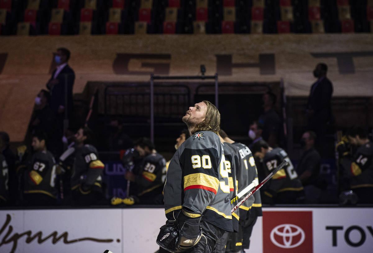 Golden Knights goaltender Robin Lehner (90) looks on while standing for the national anthem bef ...