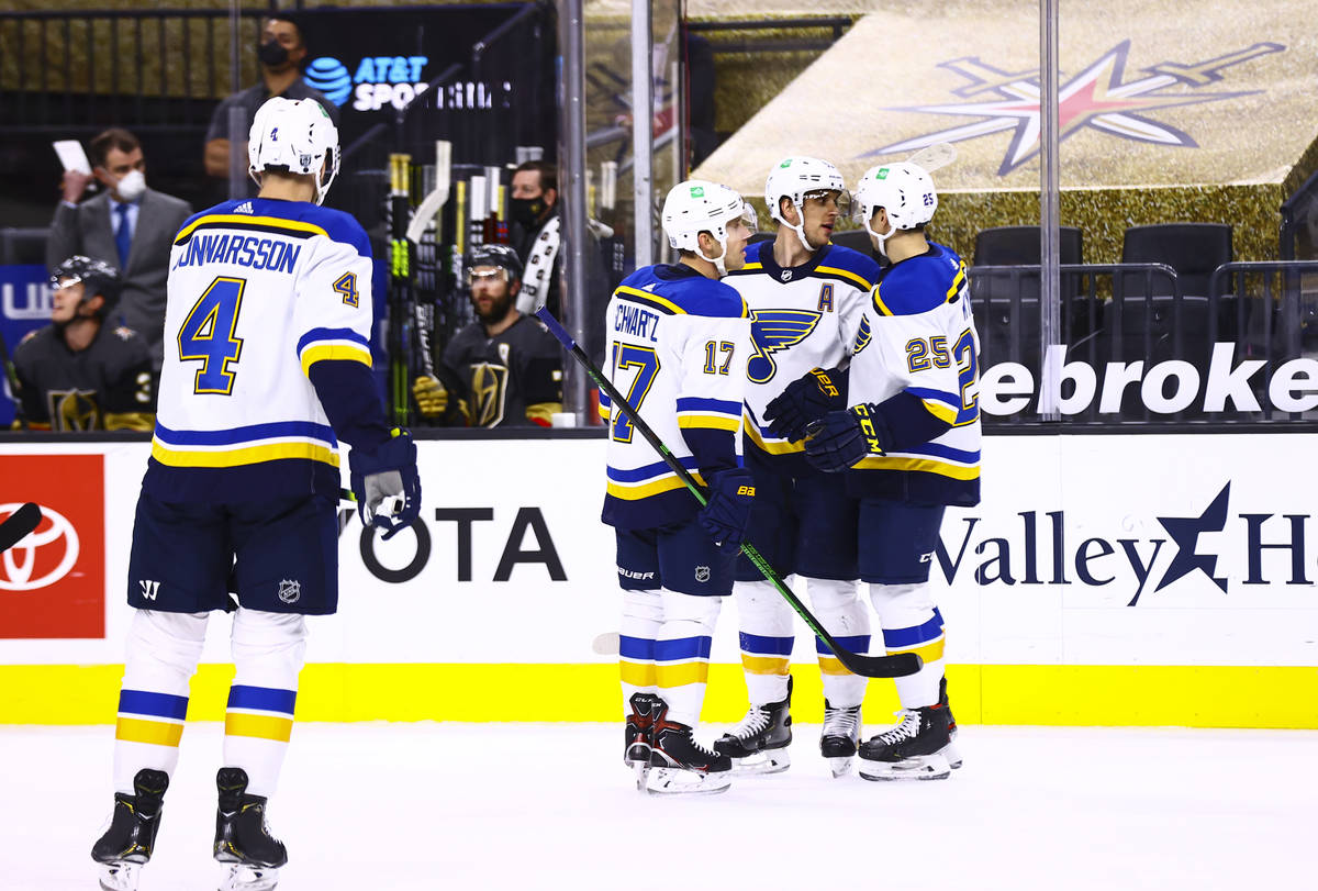 The St. Louis Blues celebrate after scoring against the Golden Knights during the first period ...