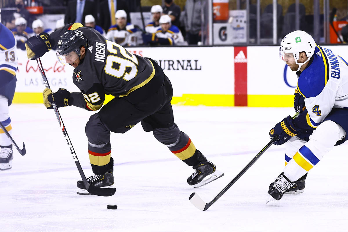 Golden Knights left wing Tomas Nosek (92) moves the puck around St. Louis Blues defenseman Carl ...