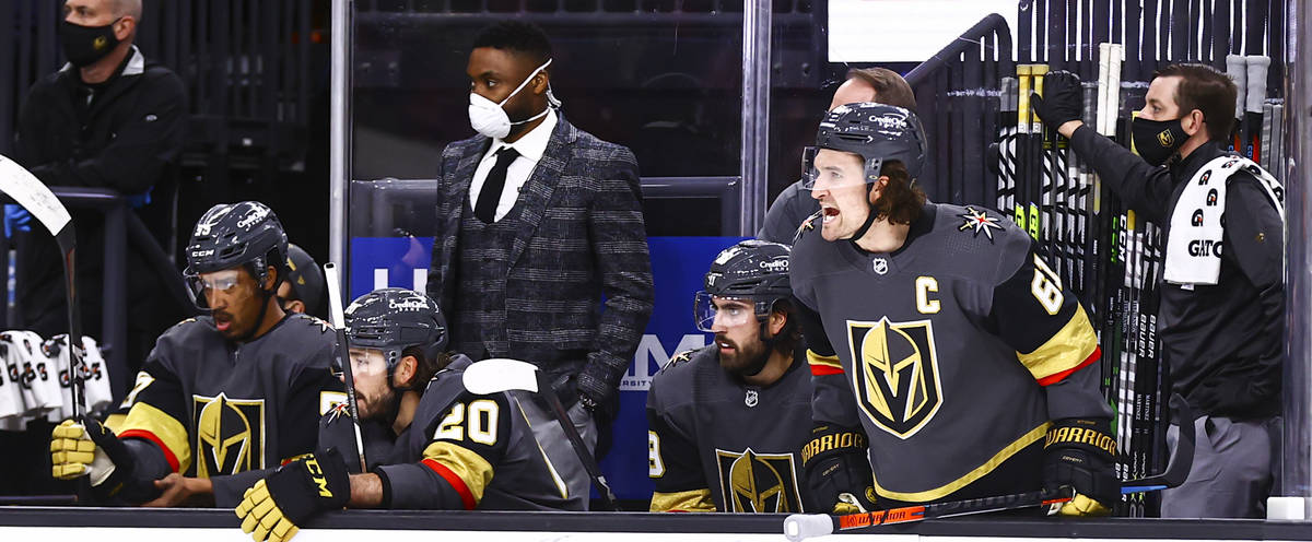 Golden Knights right wing Mark Stone (61) shouts from the bench during the second period of an ...