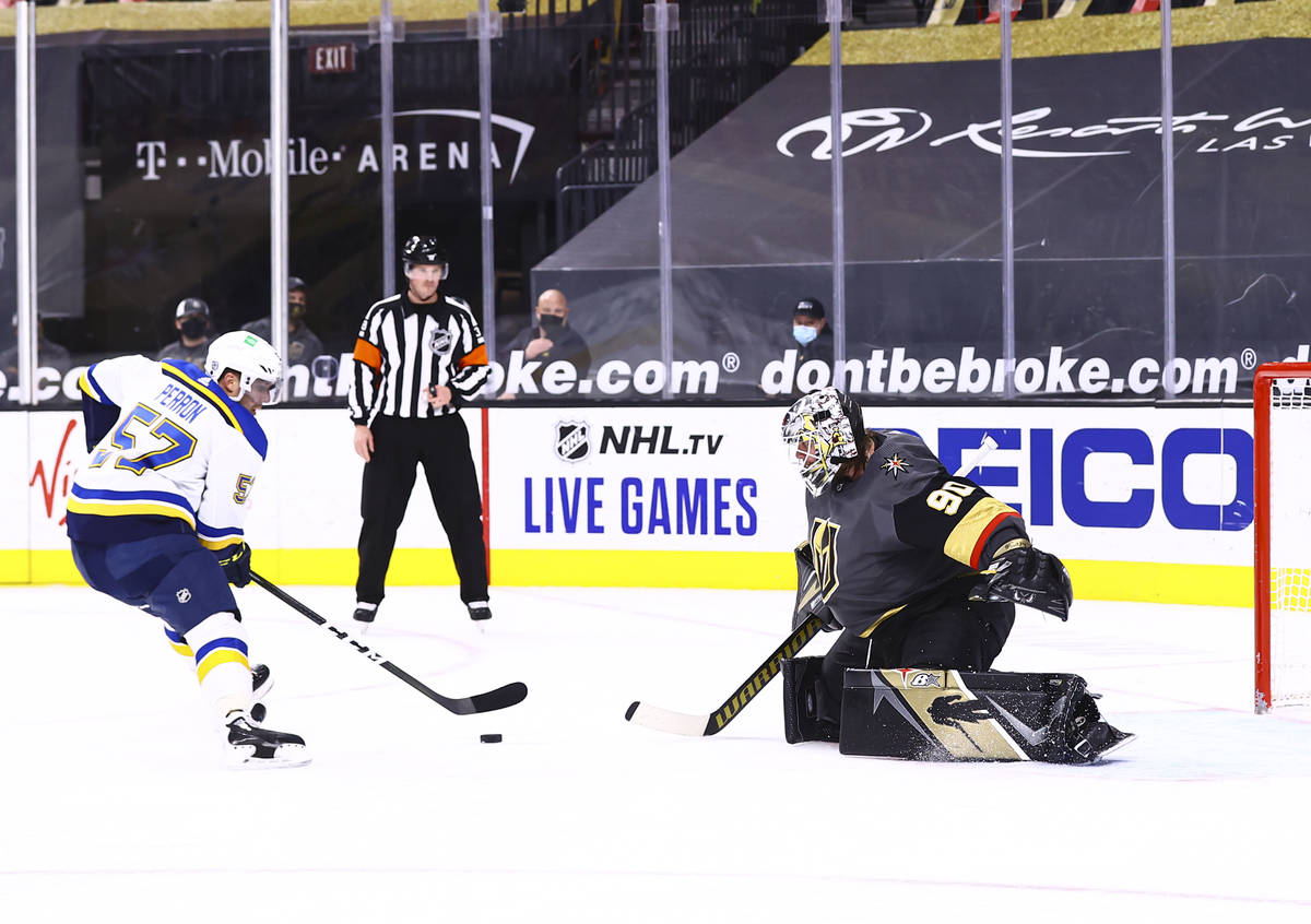 St. Louis Blues left wing David Perron (57) lines up his shot before scoring past Golden Knight ...