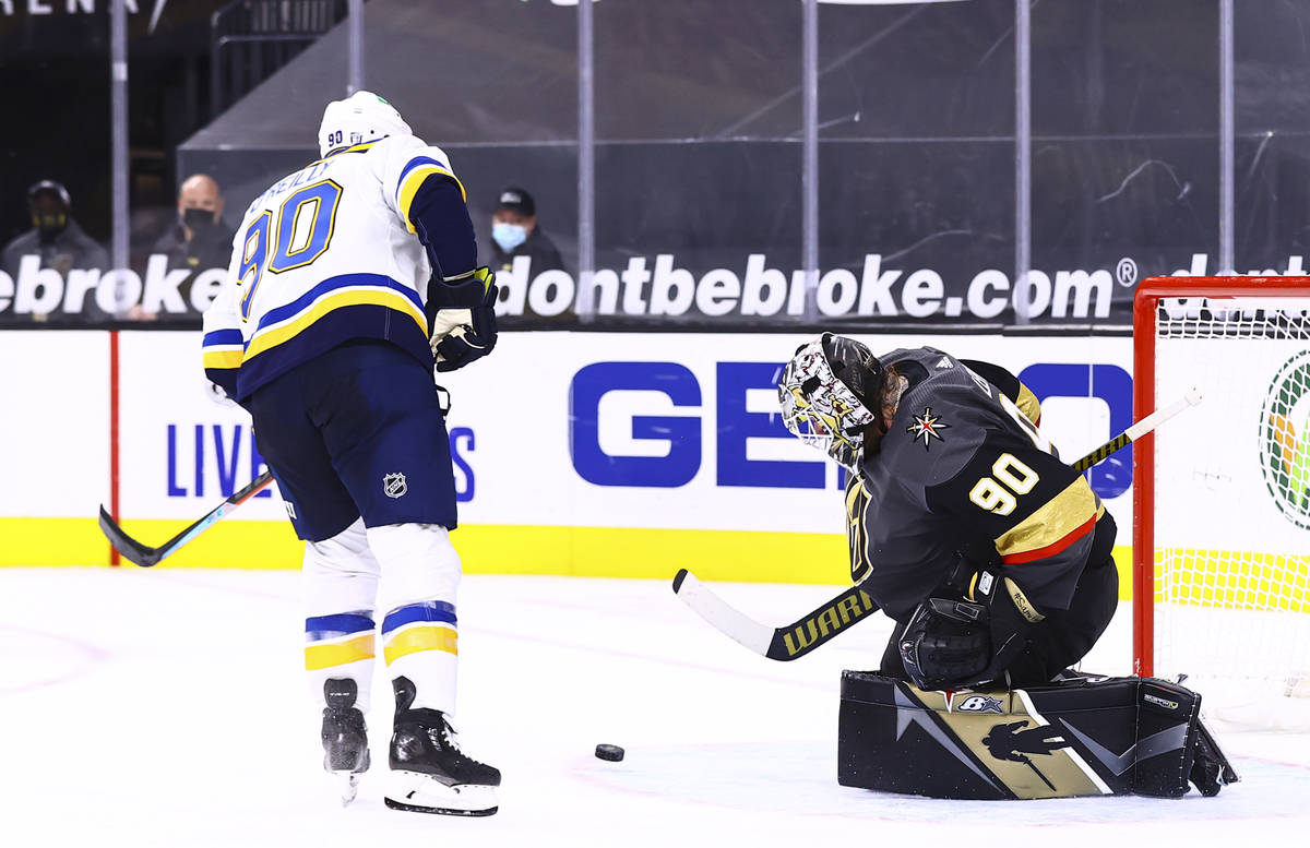 Golden Knights goaltender Robin Lehner (90) blocks a shot by St. Louis Blues center Ryan O'Reil ...