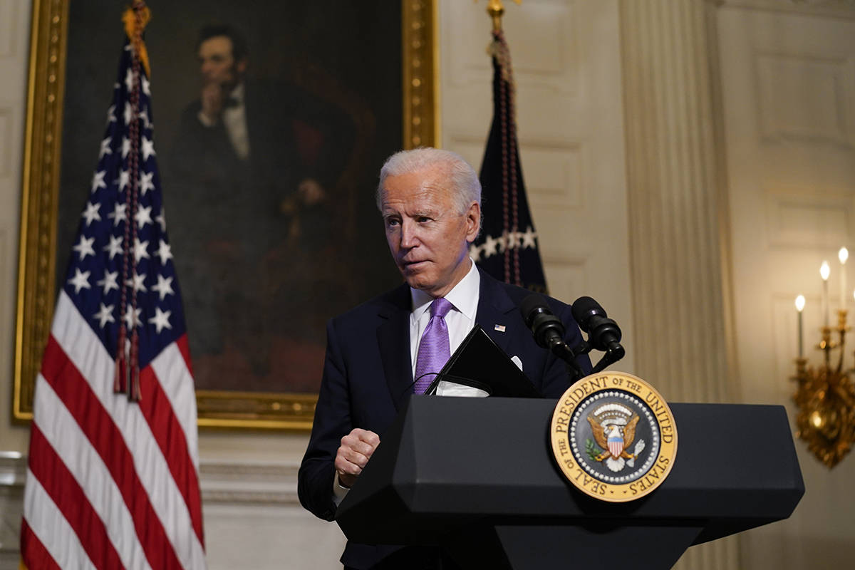 President Joe Biden leaves after delivering remarks on COVID-19, in the State Dining Room of th ...