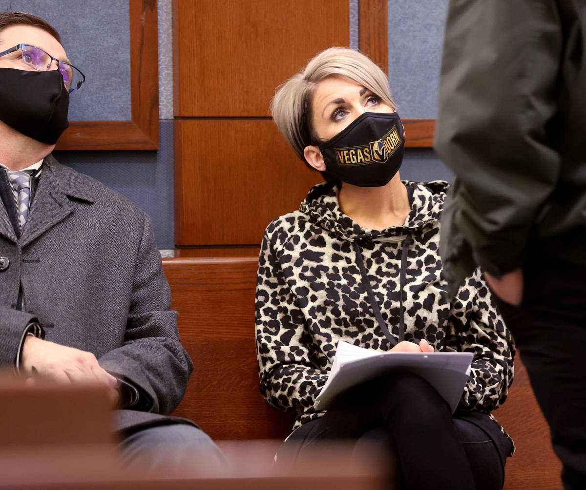 Dana Nee waits to appear in court with her attorney, Paul Andras, left, and her private investi ...