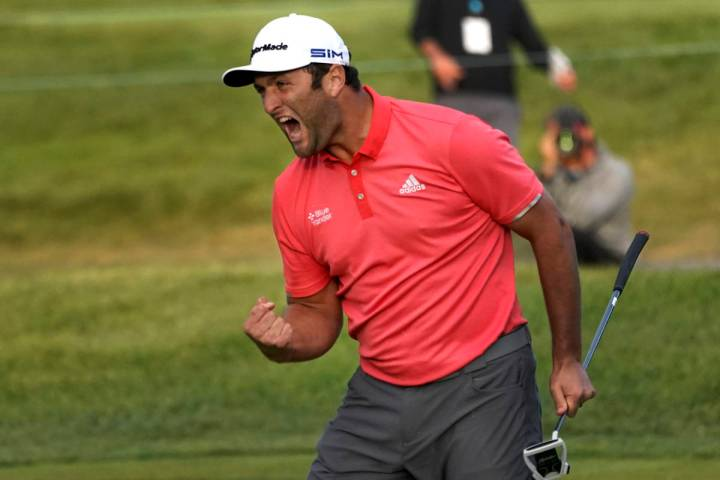 Jon Rahm reacts after making his putt on the first playoff hole during the final round of the B ...