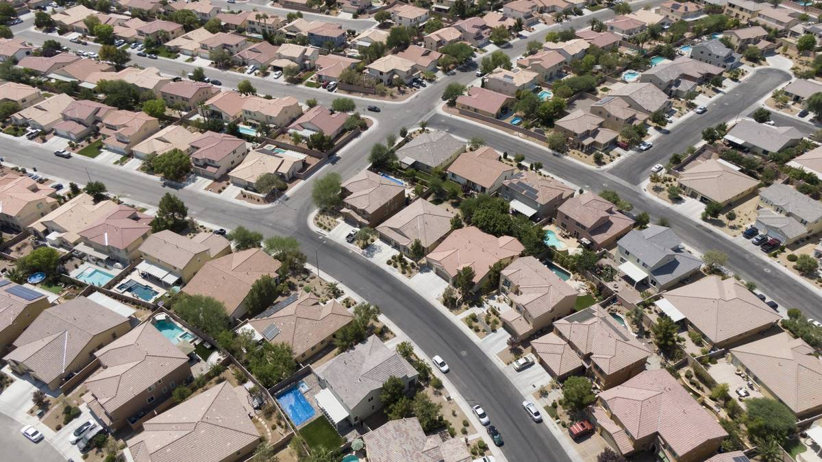 An aerial view of housing near Night Owl Bluff Avenue and West Gentle Brook Street in North Las ...