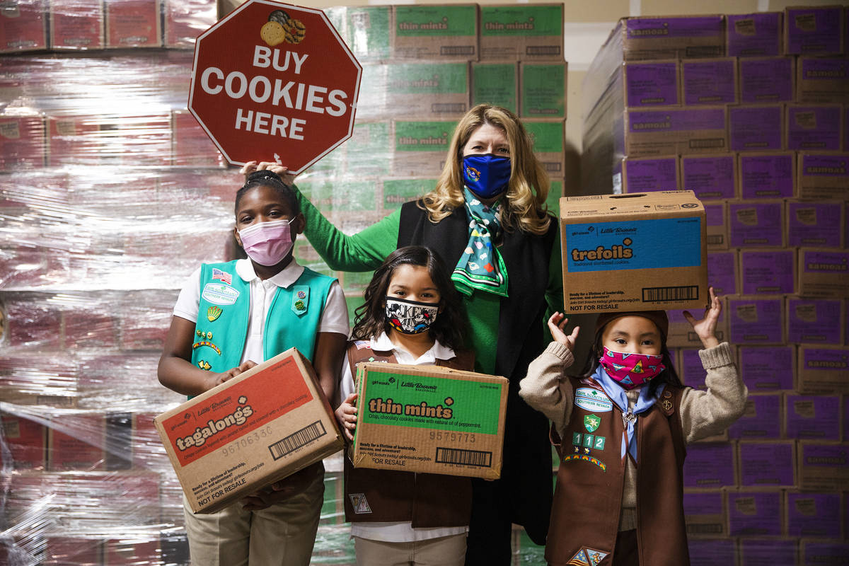 Girl Scouts Aliyah H., 9, from left, Ariana H., 7, Kimberly Trueba, CEO of Girl Scouts of South ...