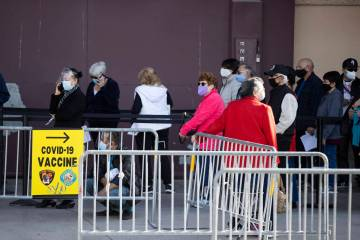 People wait in line to get the COVID-19 vaccine was the Cashman Center in Las Vegas, on Wednesd ...