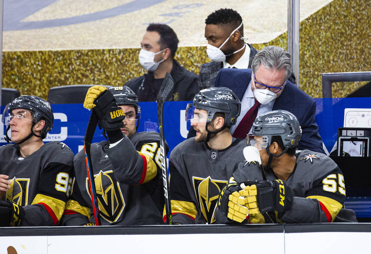 Golden Knights general manager Kelly McCrimmon, helping fill in on coaching duty, talks with pl ...
