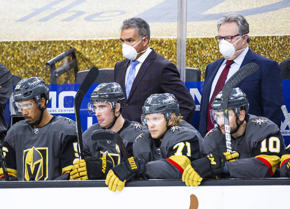 Silver Knights head coach Manny Viveiros, center left, and Golden Knights general manager Kelly ...