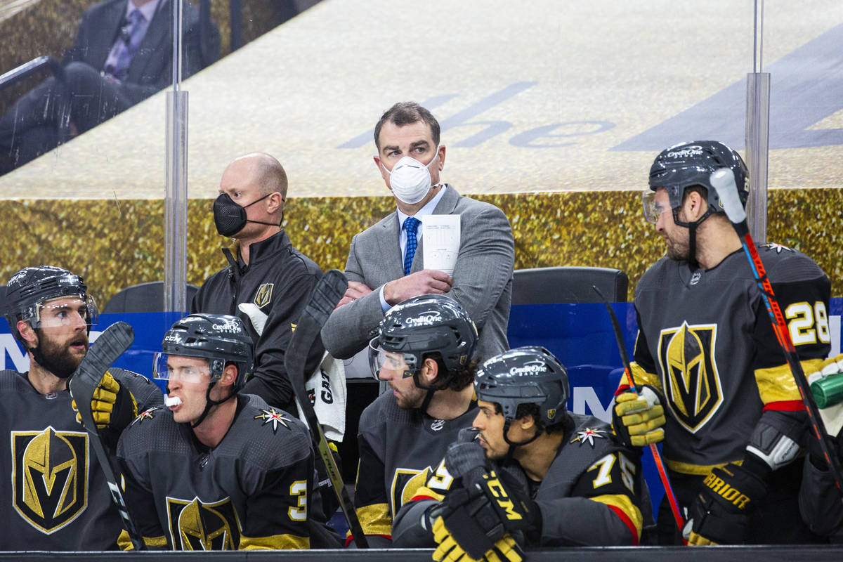 Silver Knights assistant coach Jamie Heward, center, looks on from the Golden Knights bench dur ...