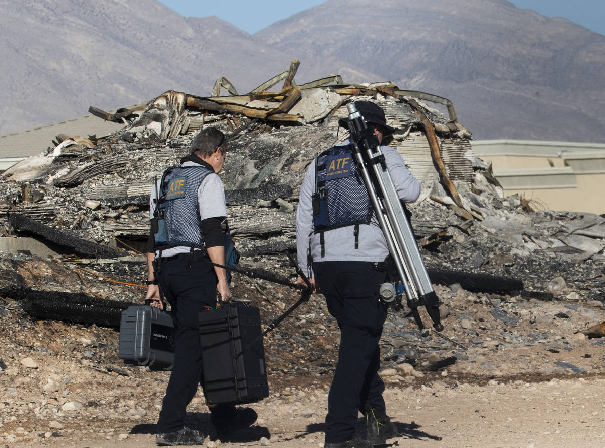 A team of Alcohol, Tobacco, Firearms and Explosives (ATF) investigators arrive at the under con ...