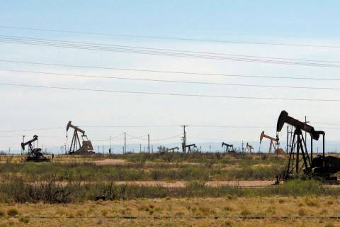 FILE - In this April 9, 2014, file photo, oil rigs stand in the Loco Hills field on U.S. Highwa ...