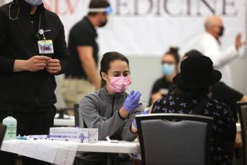 Medical student Ashley Prandecki gives a COVID-19 vaccine during a UNLV Medicine clinic in the ...