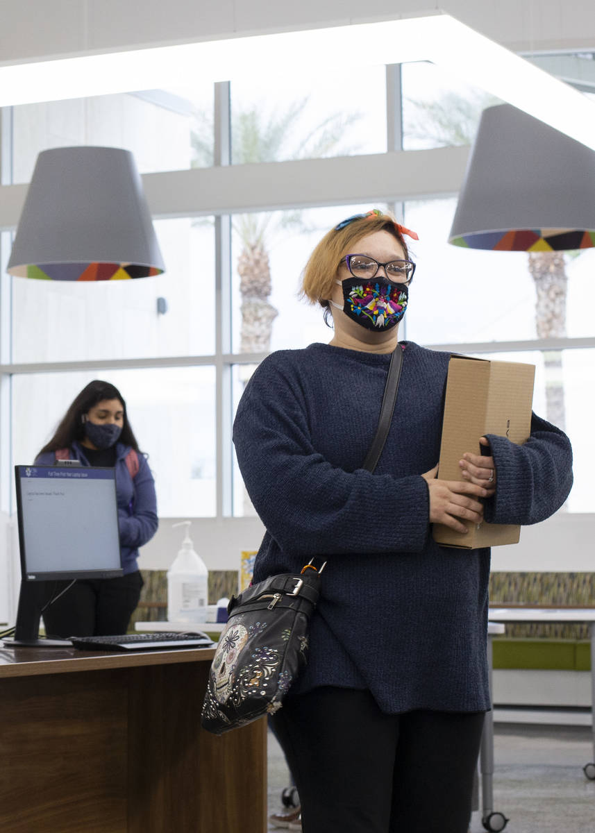 Angela Campos, a freshman at the College of Southern Nevada studying nursing, walks away with h ...